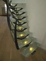 circular staircase with central stringer (metal frame and glass steps) NATURA Miroiterie RIGHETTI