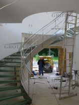 circular staircase with a lateral stringer (metal frame and glass steps) WSTEGOWE GROT