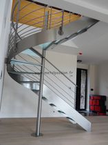 circular staircase with a lateral stringer (metal frame and glass steps)  Métal Passion