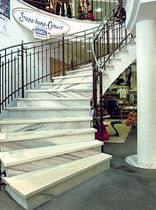 circular staircase with a lateral stringer (metal frame and marble steps)  S&ouml;lker Marmor