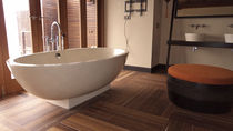 contemporary bathroom in stone and teak MALDIVES Stil Bain