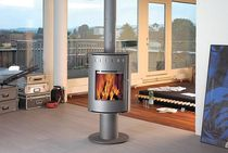 contemporary central wood-burning stove (rotating) PINA RAIS