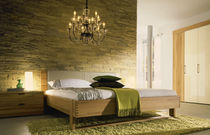 contemporary double bed with headboard upholstered in leather FLAVO hülsta