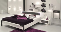 contemporary double bed with integrated bed-side table FJORA hülsta