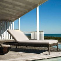 contemporary double garden sun lounger in resin wicker with casters MU by Toan Nguyen DEDON