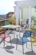 contemporary garden stacking chair with armrests SHOT by Christophe Pillet EMU