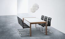 contemporary solid wood dining table SPIRIT by Stefan Westmeyer  girsberger