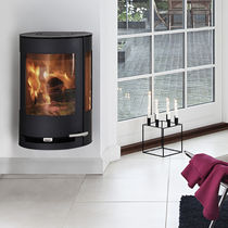 contemporary wall-mounted wood-burning stove ADURO 9-4 ADURO A/S