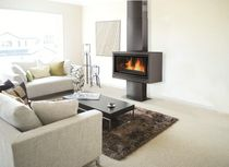 contemporary wood-burning stove (steel) VARIO 100 POD RENE BRISACH