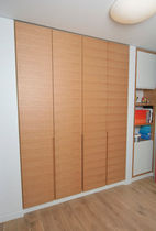 contemporary wooden wardrobe by Gatis Garvars Design Group IN