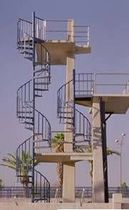 exterior spiral staircase for commercial buildings (metal frame and steps)  STAIRWAYS inc
