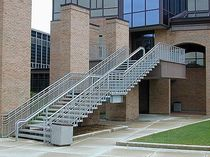 exterior straight staircase for commercial buildings  Couturier Iron Craft