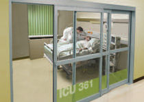 glazed fire door for commercial buildings (smoke proof) PROFILER® SMOKE RATED TELESCOPING ICU/CCU Horton Automatics