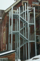 half-turn fire escape staircase in metal  New Forest Metal Work