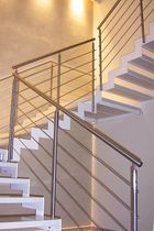 half-turn staircase with a lateral stringer MODEL 500 Interbau