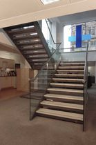half-turn staircase with a lateral stringer for commercial buildings (metal frame and wooden steps) HANOVER SQUARE SS 636 SPIRAL Stairs