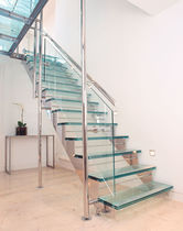 half-turn staircase with a lateral stringer (metal frame and glass steps) ENNISMORE GARDENS KD 253 SPIRAL Stairs