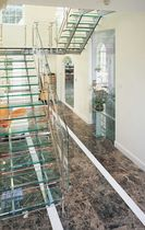 half-turn staircase with a lateral stringer (metal frame and glass steps) WENTWORTH ESTATE SS 513 SPIRAL Stairs
