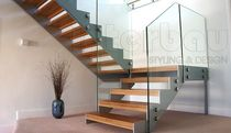 half-turn staircase with a lateral stringer (metal frame and wooden steps) MODE 500 Interbau