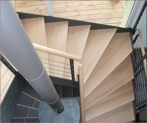 half-turn staircase with a lateral stringer (metal frame and wooden steps)  KELLER TREPPENBAU AG