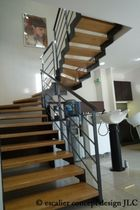 half-turn staircase with a lateral stringer (metal frame and wooden steps) ELCR-CAM la stylique