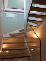 half-turn staircase with a lateral stringer (metal frame and wooden steps) ELF-MOT la stylique