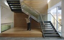 half-turn staircase with a lateral stringer for commercial buildings BAKER STREET SS 700 SPIRAL Stairs