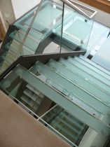 half-turn staircase with a lateral stringer for commercial buildings (metal frame and glass steps) HENLEY SAXUM