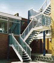 half-turn staircase with a lateral stringer for commercial buildings (metal frame and steps) KINGS HOUSE SCHOOL FIRE ESCAPES