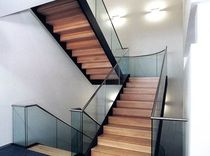 half-turn staircase with a lateral stringer for commercial buildings (metal frame and wooden steps)  Nautilus