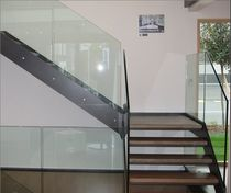 quarter-turn staircase with a lateral stringer (metal frame and wood steps)  KELLER TREPPENBAU AG