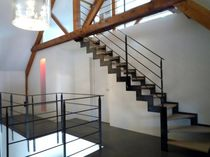 quarter-turn staircase with a lateral stringer (metal frame and wood steps) ELCR-DEF la stylique