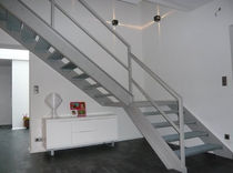quarter-turn staircase with a lateral stringer for commercial buildings  Formadour