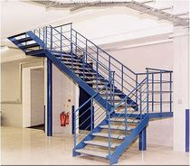 quarter-turn staircase with a lateral stringer for commercial buildings (metal frame and wooden steps)  Crescent Stairs