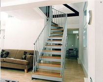 quarter-turn staircase with a lateral stringer (metal frame and wood steps)  Crescent Stairs