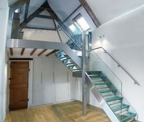 quarter-turn staircase with a lateral stringer (stainless steel frame and glass steps) RATTERY SAXUM
