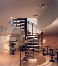 spiral staircase for commercial buildings (metal frame and wooden steps)  Crescent Stairs