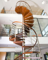 spiral staircase for commercial buildings (metal frame and wooden steps)  Kevala Stairs Limited