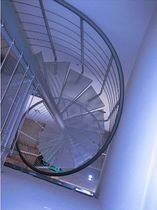 spiral staircase (metal frame and metal grid step) ATRIUM SYSTEM PERFO Atrium