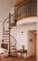 spiral staircase (metal frame and wooden steps) 52S STAIRWAYS inc
