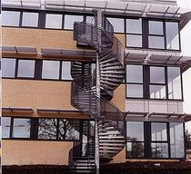 spiral staircase with a lateral stringer for commercial buildings (metal frame and steps) FULBOURN Crescent Stairs