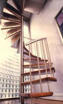 spiral staircase (stainless steel frame and wood steps)  STAIRWAYS inc