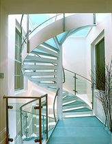 spiral staircase with a lateral stringer (metal frame and glass steps)  Crescent Stairs