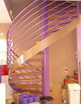 spiral staircase with a lateral stringer (metal frame and wooden steps)  Formadour