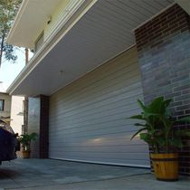 steel sectional garage door IDO-HOME IDOMUS Ltd.