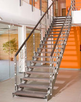 straight staircase with a lateral stringer for commercial buildings (metal frame and wooden steps)  Kevala Stairs Limited
