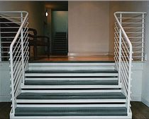 straight staircase with a lateral stringer (metal frame and glass steps)  Crescent Stairs