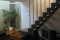 straight staircase with a lateral stringer (metal frame and wood steps) by Marco Dellai  mauropedergnana