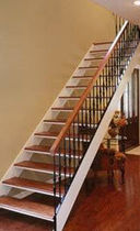 straight staircase with a lateral stringer (wooden frame and steps)  STAIRWAYS inc