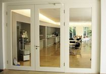 wooden double swing door with glass pane CIMEX AG LOCK-UP Haring Engineering Ltd